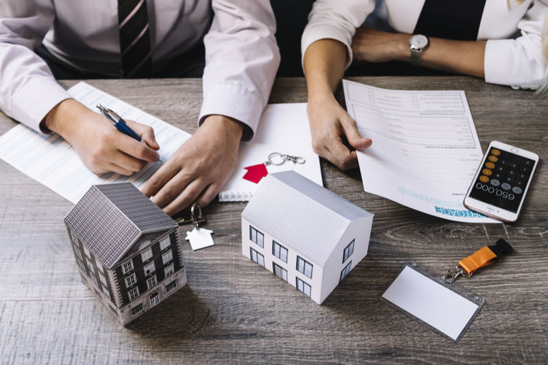 Mortgage brokers going over documents